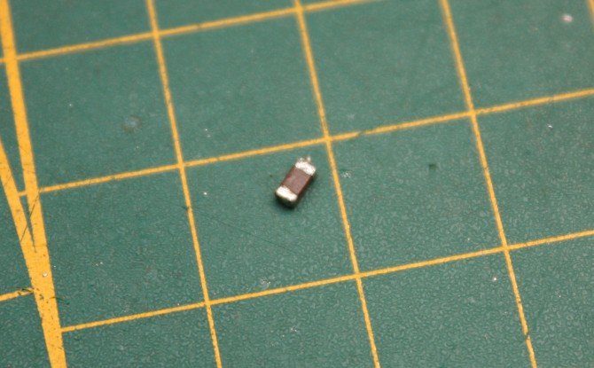 Old capacitor, action like resistor of 45K